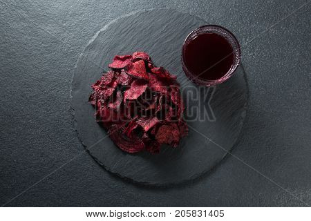 Overhead view of beetroot with juice on plate over slate