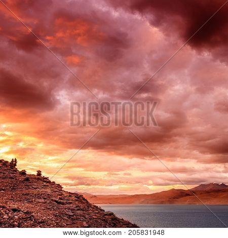 Dramatic sunset sky over lake Tso Moriri in the Himalayas, Kashmir, India