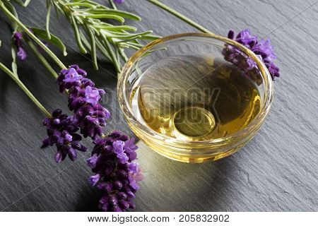 Lavender Essential Oil In A Glass Bowl