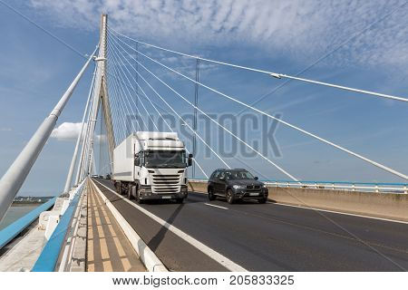 LE HAVRE FRANCE - AUGUST 24 2017: Traffic at Pont de Normandie French bridge over river Seine near Le Havre and Honfleur