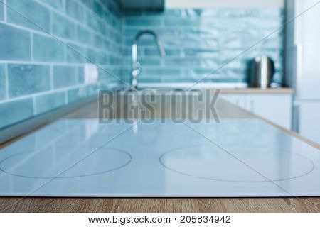 View of the kitchen with white hob