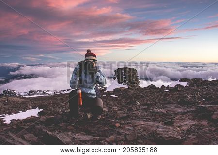 Girl photographer at the top of a mountain