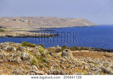 The most beautiful coasts of Italy: adriatic sea of Salento (Apulia). The Otranto-Santa Maria di Leuca Coast and Tricase Woods regional nature park: in the background Sant 'Emiliano tower and trullo.