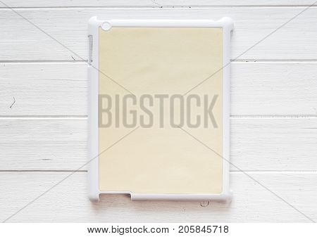 White tablet Cover for your design or text on a white wooden table