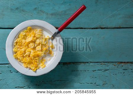Close-up of breakfast cereals in bowl on wooden table