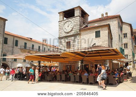 Kotor, Montenegro - June 15, 2017: Touristsin the Square of the Arms in Old town of Kotor