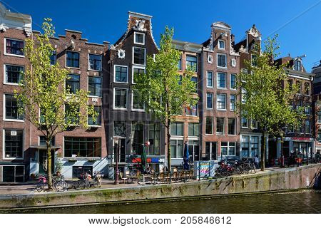 AMSTERDAM, NETHERLANDS - MAY 8, 2017: Amsterdam Red-lights district De Wallen. It is the largest and best known red-light district in Amsterdam and popular tourist attraction