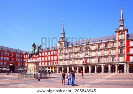 Madrid, Spain - September 2, 2016: Tourists in The Main Square (Plasa Mayor) in Madrid