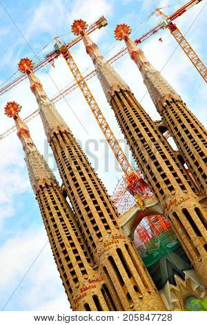 Barcelona, Spain - June 09, 2011: Angle shot of bell towers of The La Sagrada Familia cathedral by Antoni Gaudi in Barcelona