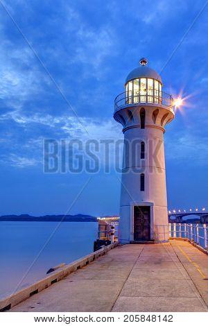 Nightfall On Singapore Lighthouse At Tuas