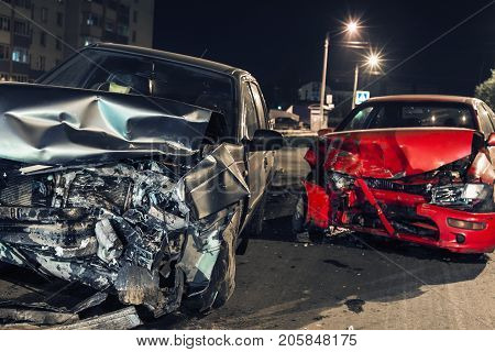 Collision between two cars on the asphalt road