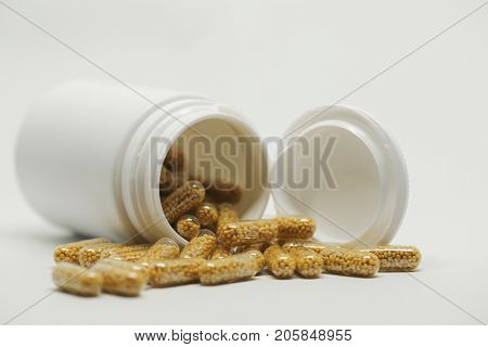 a dose of vitamin pills against isolated background