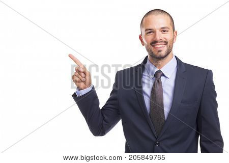 Handsome businessman pointing finger at copyspace, isolated on a white background