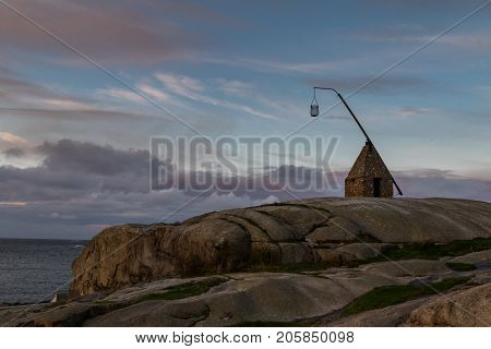 Old lighthouse at Verdens Ende, Vestfold, Norway. This lighthouse is made of rocks found at the beaches nearby.