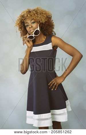 African Caribbean Woman with afro hair with vintage seventies clothing