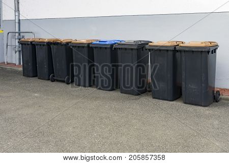 Lot of grey garbage can in a row