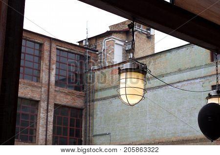 Unusual street lamp. Vintage street lamp in the evening.