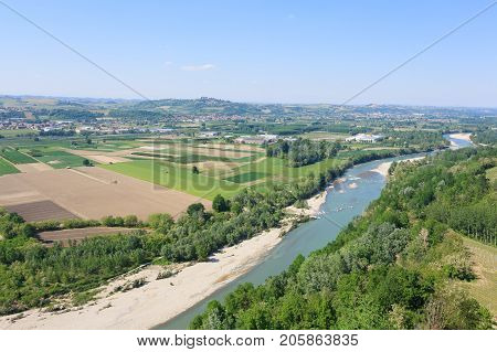 Tanaro river view. Vineyards from Langhe regionItaly agriculture. Unesco world heritage site
