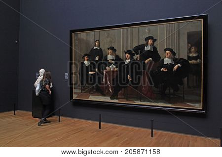 AMSTERDAM, THE NETHERLANDS - MAY 4, 2016: Visitors at the famous Rijksmuseum in Amsterdam, Netherlands.