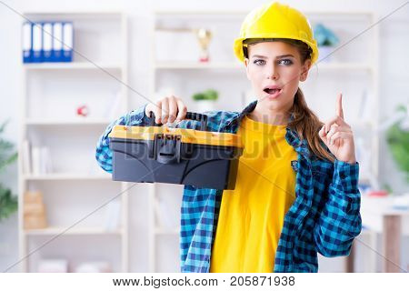 Woman with toolkit in workshop
