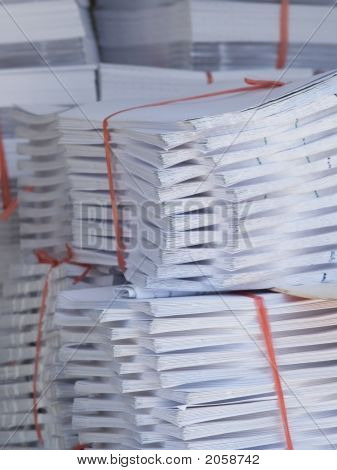 Stacks Of Paper At A Printshop