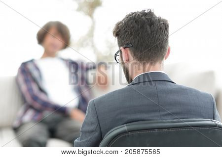 lawyer advises his client. back view. concept of confidentiality.