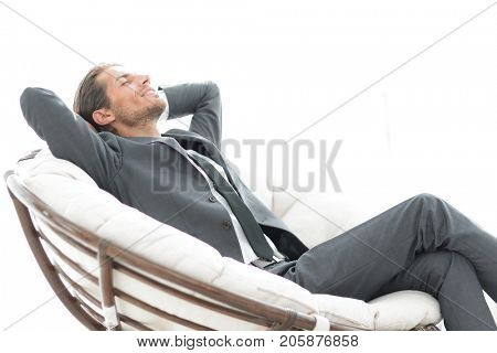 young businessman sitting in large comfortable armchair.