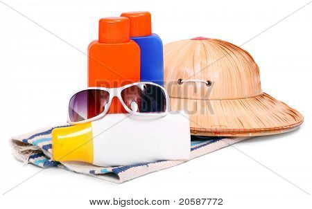 UV protection equipment for happy holidays. Sunglasses, hat and sun lotion.