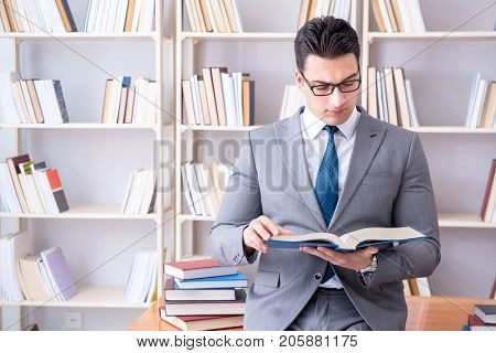 Business law student working studying in the library