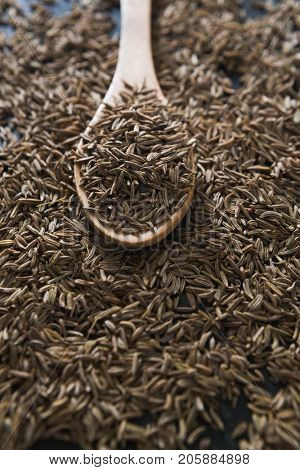 Close-up of cumin with spoon