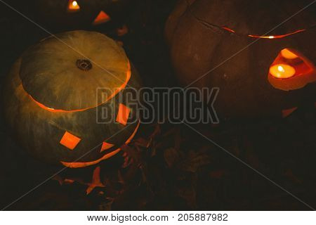 High angle view of jack o lantern glowing in darkroom during Halloween