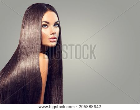 poster of Beautiful long Hair. Beauty woman with luxurious straight black hair on dark background. Beautiful brunette Model girl with Healthy Hair. Lady with long smooth shiny straight hair. Hairstyle, cure
