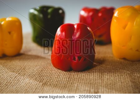 Close up of carved colorful bell peppers on sack