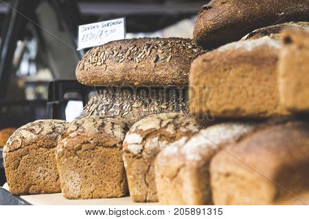 Closeup Of Sourdough And Rye Bread Loaves In Street Market