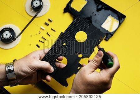 Hand separate a parts of videotape apart