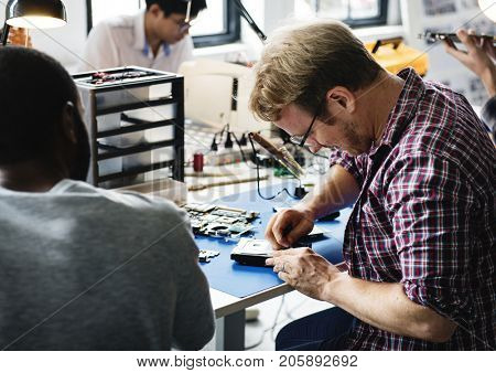 Technicians working on computer hard disk