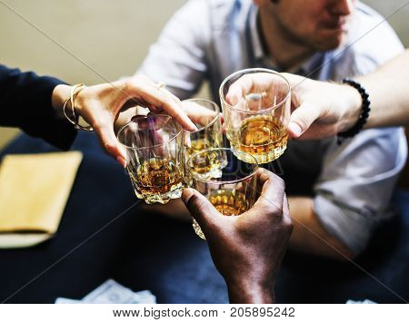 Hands clinging alcohol drink glasses