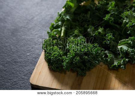 Close-up of mustard greens on chopping board