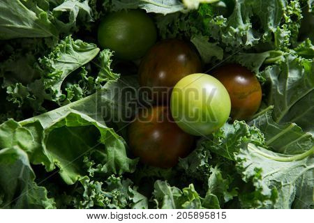 Close-up of fresh mustard greens and gooseberry