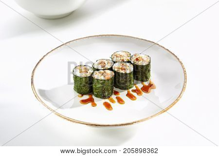 Traditional maki rolls with eel served on white flat plate. Asian menu for gourmets in luxury restaurant