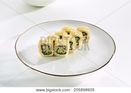 Hot rolls California with crab meat and Japanese mayonnaise served on white flat plate. Asian menu for gourmets in luxury restaurant