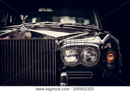 GDANSK, POLAND - September 8th. Rolls-Royce - classic British car on black background, close-up. Rolls-Royce remains a symbol of a luxurious car.