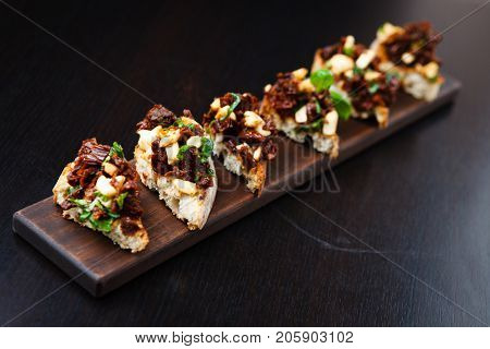 Fresh bruschetta with cheese and sundried tomatoes