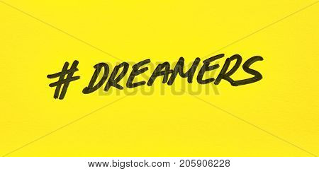 Popular hashtag dreamers written on a yellow paper