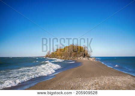 View of the tip of Point Pelee National Park beach in the fall at sunset time, lake Erie, southwestern Ontario, Canada
