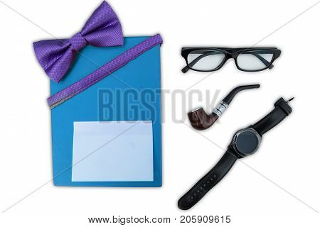 Top view of gift box with a blank sticky note near an eyeglasses smoke pipe and wristwatch isolated on white background