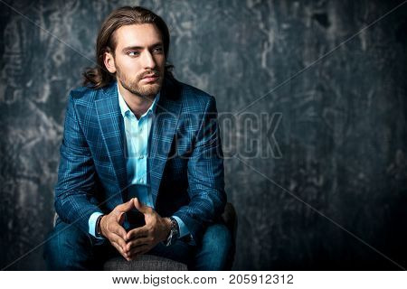 Portrait of a handsome young man in elegant classic suit. Men's beauty, fashion. Business style.