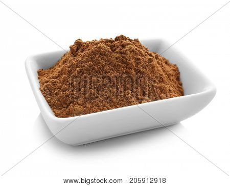 Bowl of cumin spice on white background