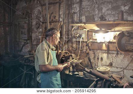 Artisan using a rasp