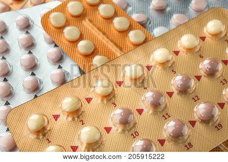 Different birth control pills, closeup. Oral contraception concept